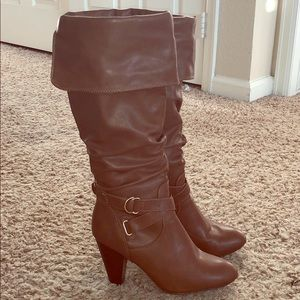 Tall brown high heel boots